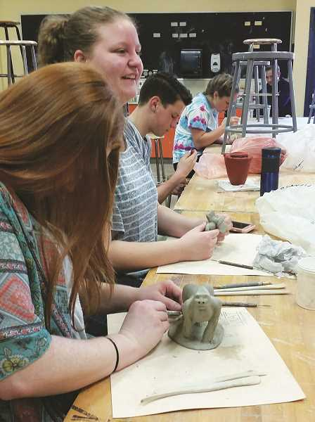ALISSA TRAN - MHS students Hannah Hale, Stephanie Rivera and Clayton Crabtree creating clay sculptures