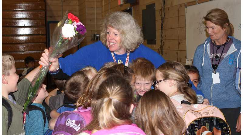 HOLLY SCHOLZ - Crooked River Elementary Principal Cheri Rasmussen returned to ecstatic staff and students Thursday morning, receiving hugs, flowers — and even a showering of silly string.