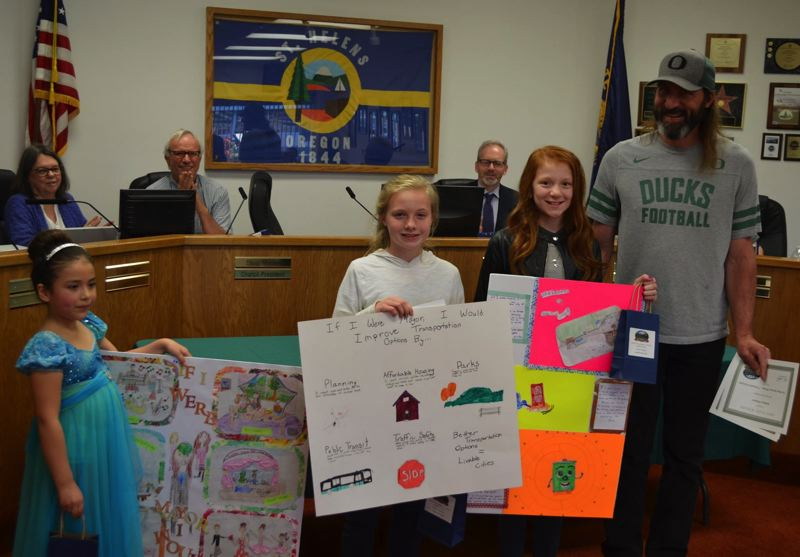 COURTESY PHOTO OF THE CITY OF ST. HELENS - From left to right: Giovanna Anderson, Rebecca Freitag, Isabella Hayward and Mayor Rick Scholl. Freitag was the winner of the fourth- through fifth-grade poster contest.