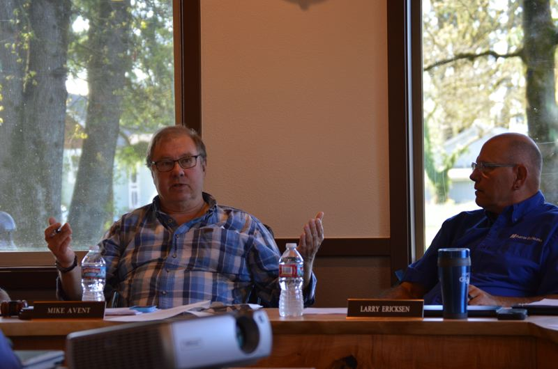 SPOTLIGHT PHOTO: COURTNEY VAUGHN - Port of St. Helens Commissioners Mike Avent (left) and Larry Ericksen grapple with spending additional money for attorney's fees to rezone property in Clatskanie. Commissioners ultimately approved the $15,000 expenditure.