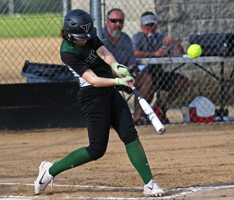 DAN BROOD - Tigard High School sophomore Sarah Moss gives the ball a ride during the Tigers' game at Sherwood. Tigard came away with a 6-1 victory.