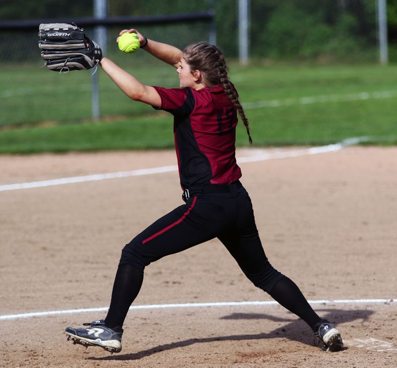 DAN BROOD - Sherwood sophomore Josie Reid gets ready to fire in a pitch during Sherwood's game with Tigard.