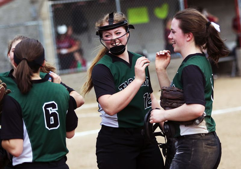 DAN BROOD - The Tigard High School softball team, including Maddie Hoover (6), Ashley Davis (center) and Caroline Riggs are all smiles following the win at Sherwood.
