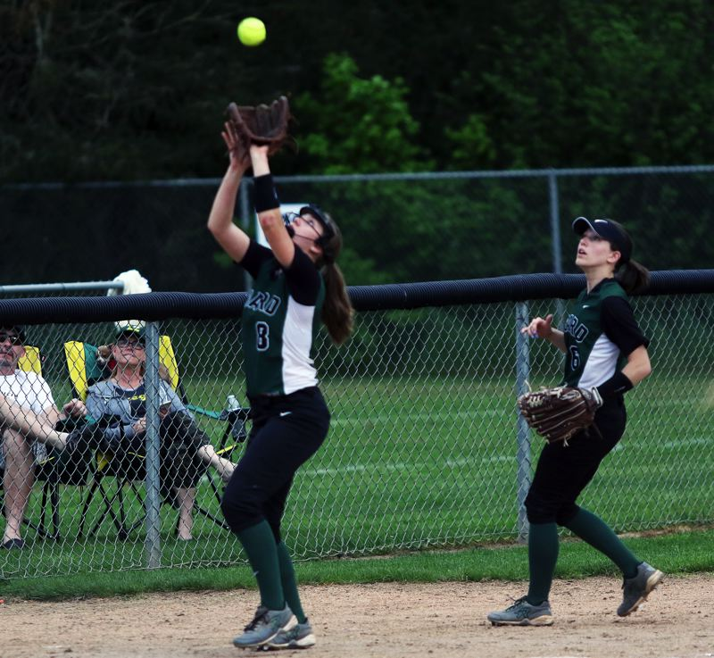 DAN BROOD - Tigard third baseman Abby Soderquist gets under the ball during the Tigers' game at Sherwood.