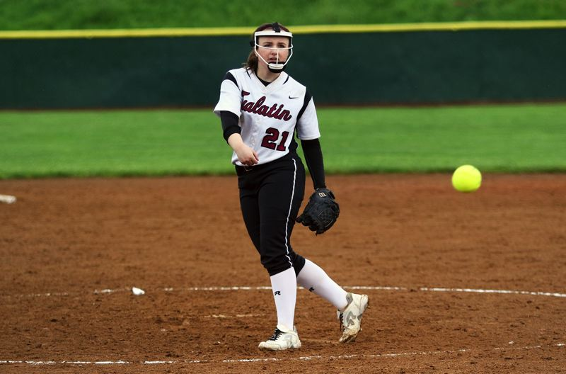 DAN BROOD - Tualatin High School sophomore Megan Woodward fires in a pitch during the Timberwolves' 4-0 win over Tigard.