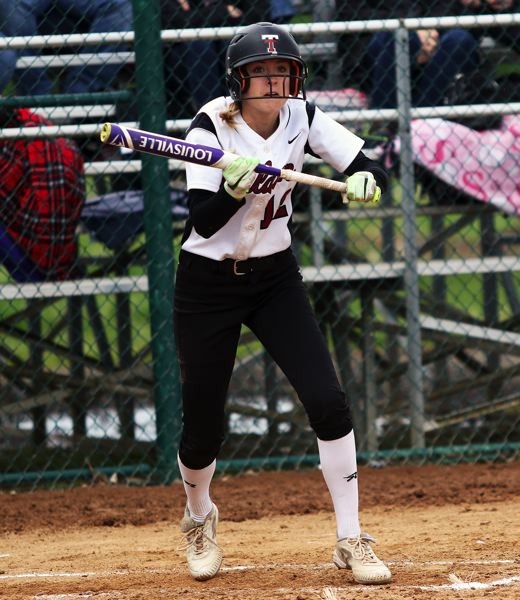 DAN BROOD - Tualatin junior Ella Hillier looks to put down a bunt during the Wolves' game with Tigard.