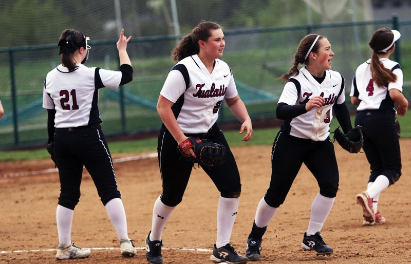 DAN BROOD - Tualatin players (from left) Megan Woodward, Emily Johansen, Amanda Reser and Bella Valdes head back to their positions after meeting in the pitcher's circle.