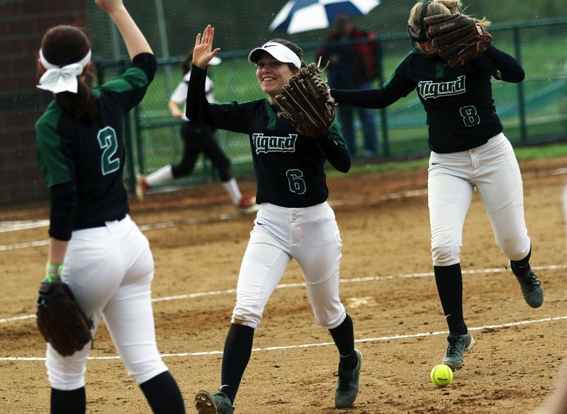 DAN BROOD - Tigard sophomore shortstop Maddie Hoover (6) is congratulated by her teammates after making a defensive play during the Tigers' game at Tualatin.