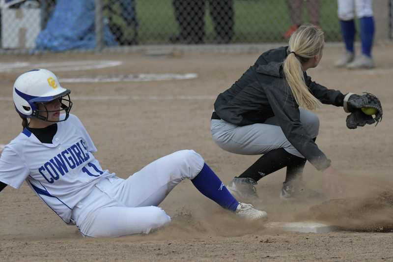 LON AUSTIN/CENTRAL OREGONIAN - Crook County's McKuenzie McCormick slides safely into second as Madras second baseman Kianna Moschetti catches the ball.