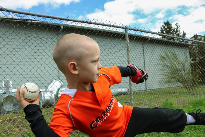 OUTLOOK PHOTO: ZANE SPARLING - A very-little Little Leaguer winds up for the pitch.