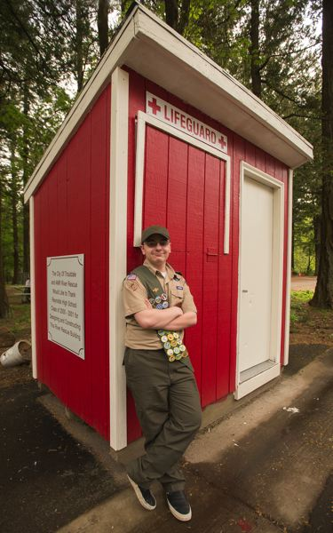OUTLOOK PHOTO: JOSH KULLA - Gresham Boy Scout Matthew Merritt repainted and repaired the roof on this lifeguard shack at Glenn Otto City Park in Troutdale. The shack is used each summer by lifeguards at the park's Sandy River beach.