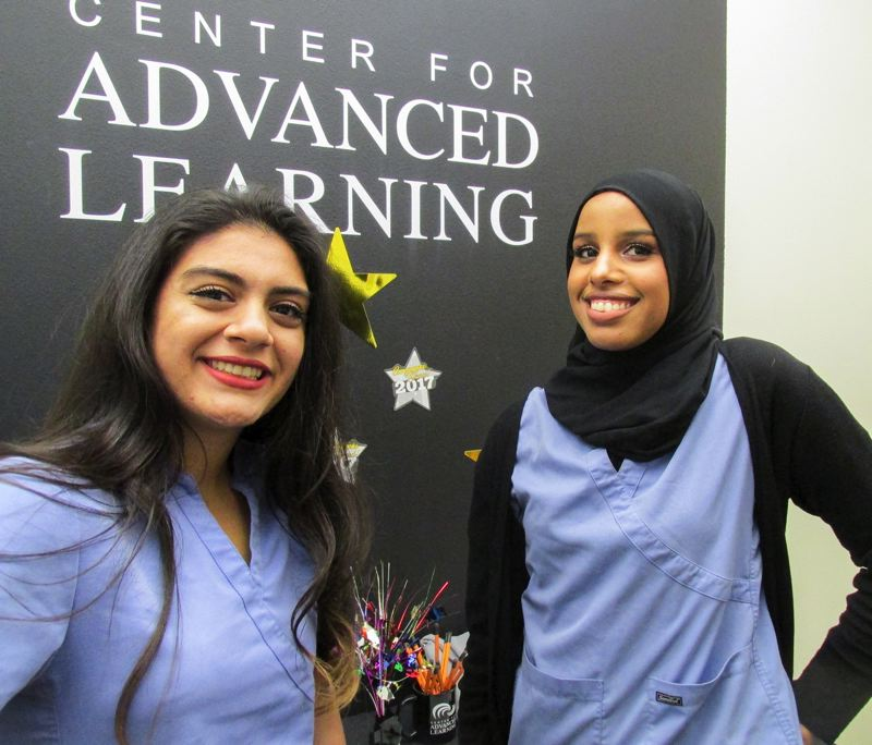 OUTLOOK PHOTO: TERESA CARSON - Agrin Niroumand, left, and Ismahan Dahir, plan to use their $10,000 scholarships from Kaiser Permanente to become doctors and work in Third World countries.
