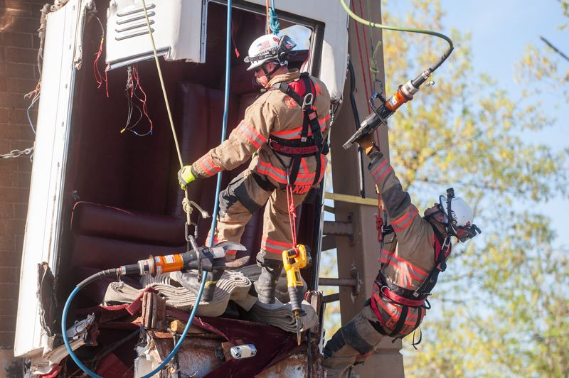OUTLOOK PHOTO: JOSH KULLA - Gresham firefighters Grant Kimble and Tyson Guillory take part in an urban search-and-rescue exercise on Friday, May 5, involving a limousine that went over a simulated cliff, necessitating a rescue effort.