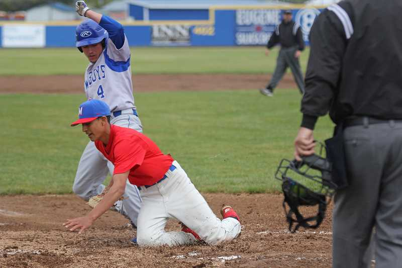 WILL DENNER/MADRAS PIONEER - Crook County's Rowdie Dalton (4) scored the game's first run in the top of the first after Madras starting pitcher Aaron Winishut (red) sailed a pitch behind home plate.