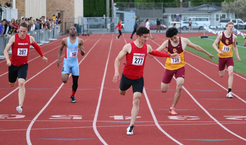 Rieker Daniel leads OC boys to district track co-title