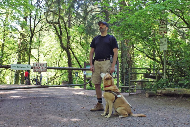 PORTLAND TRIBUNE: LYNDSEY HEWITT - Alex Schay, who is blind, often hikes in Forest Park with his guide dog, Clifton. Although he hasn't had many run ins with cyclists at Forest Park, he has at Powell Butte, and worries that expanded access could frighten elderly hikers.