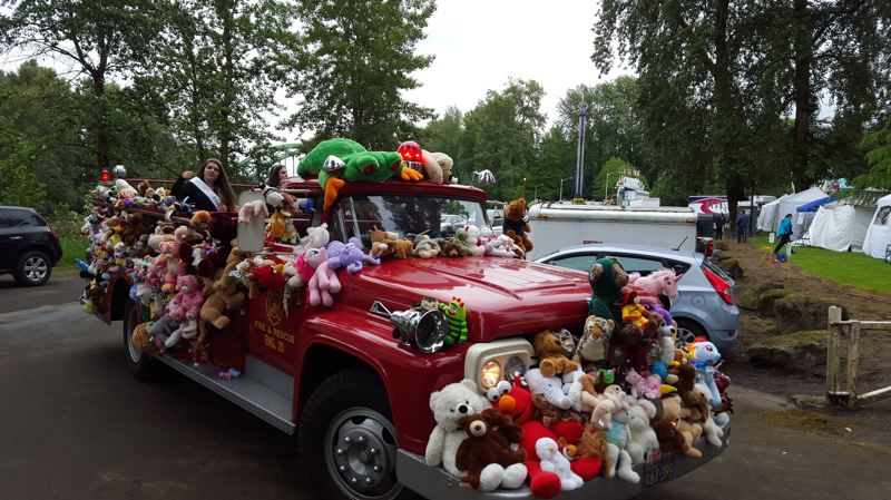 SUBMITTED PHOTO - Oregon City's annual Teddy Bear Parade collects new stuffed animals for local police agencies, fire departments, emergency rooms, children's hospitals and women's shelters.