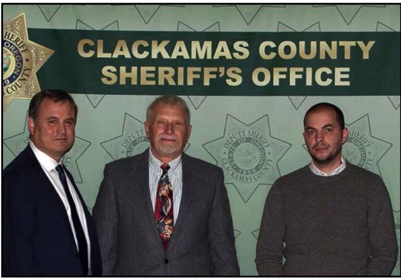 SUBMITTED PHOTO - John Kilstrum (middle) and Rustam Abbasov (right) accept their Public Service Award from Clackamas County Sheriff Craig Roberts (left).