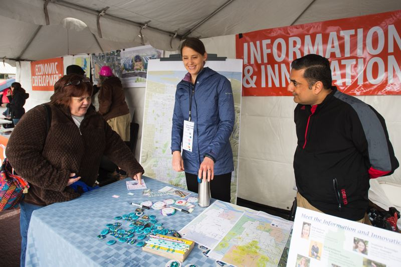 OUTLOOK PHOTO: JOSH KULLA - Gresham resident Sally Price talks with city of Gresham staffers Stephanie Betteridge and Aman Singh Saturday at CityFest.