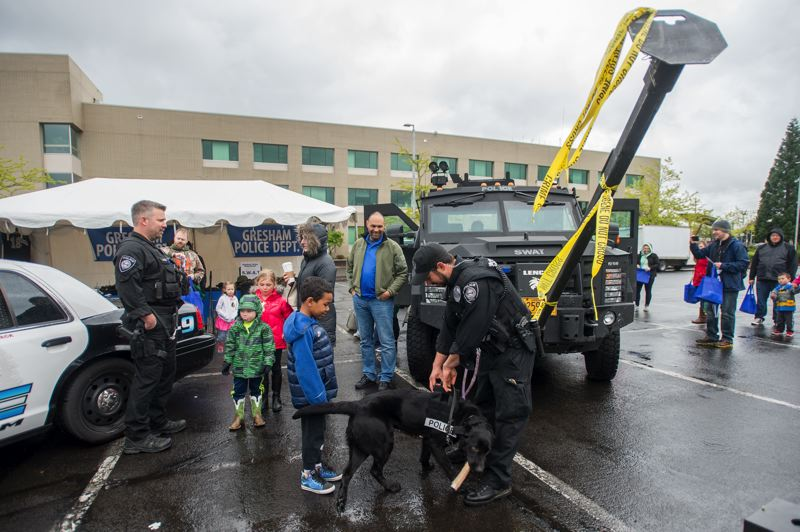 OUTLOOK PHOTO: JOSH KULLA - Gresham Police Officer Jeff Culp and his K9 partner Cash show off the latter's drug detection skills Saturday at the city of Gresham's CityFest event.