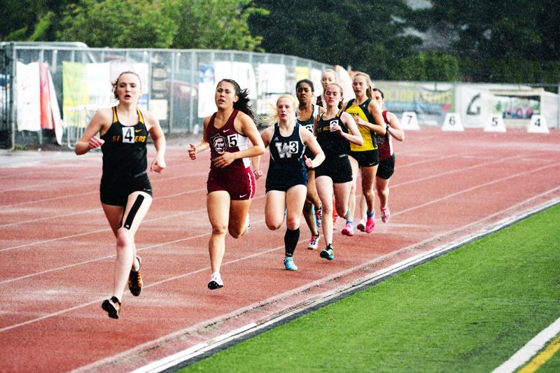 SPOTLIGHT PHOTO: JAKE MCNEAL - Lions senior Josie Hanna beat Wilsonville freshman Samantha Prusse (2 minutes, 26.98 seconds) for the Northwest Oregon Conference girls' 800-meter run championship in 2:26.06, and came up second in the 1,600 relay to Wilsonville (4:15.20) with Isabelle Wallace, Cheyenne Trainer and Mackenzie Carlson (4:15.76).