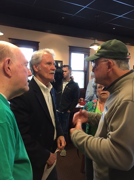 PAMPLIN MEDIA GROUP: PETER WONG - Former Gov. John Kitzhaber speaks to Bill Kroger, right, after a Washington County Public Affairs Forum luncheon Monday, May 15, in Beaverton