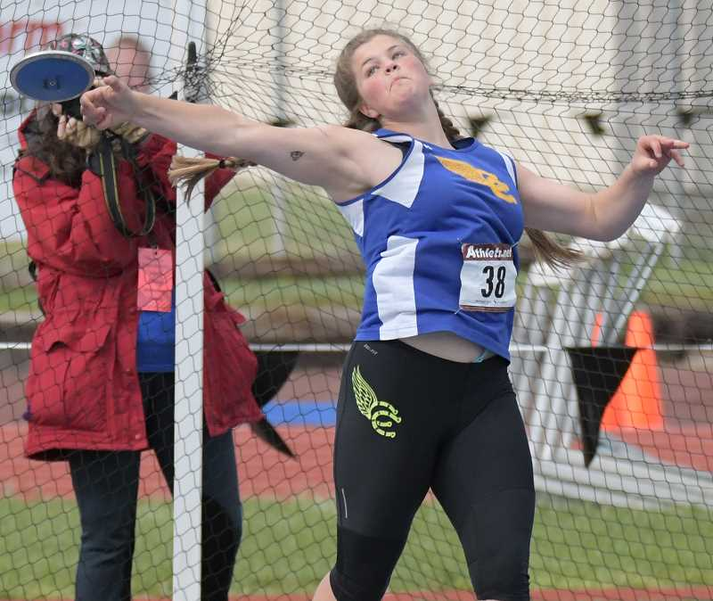 LON AUSTIN/CENTRAL OREGONIAN - Kenna Woodward throws the discus 123-00 to finish second and qualify for the state championships.