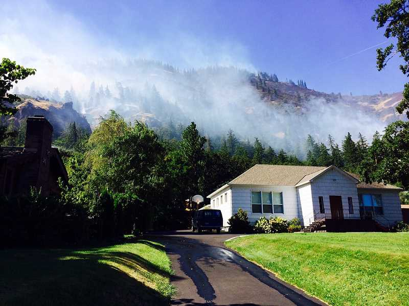 COURTESY PHOTO: OREGON DEPARTMENT OF FORESTRY - Create a fire-resistant circle of safety around your home to protect it from wildfire.