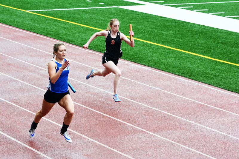 SPOTLIGHT PHOTO: JAKE MCNEAL - Indians senior Alyssa Spang won the Cowapa League girls' 400-meter dash championship in 1 minute, .29 seconds, followed freshman teammate Emma Jones' personal-best 46.52 in 47.69 in the 300 hurdles and helped Jones, Linnaea Kavulich and Tess Conway (4:09.13) to second in the 1,600 relay behind Valley Catholic (4:09.03).