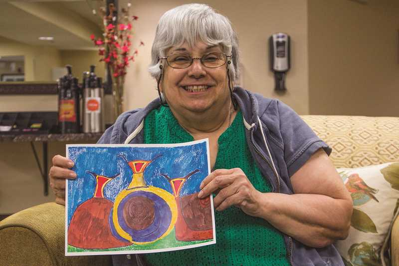 "INDEPENDENT PHOTO: JULIA COMNES - Raquel Sanchez's painting, ""Garden Snails,"" was recently sold at an Alzheimer's Association art auction. The Silver Creek resident says learning to paint has helped her with some of her epilepsy and dementia symptoms."