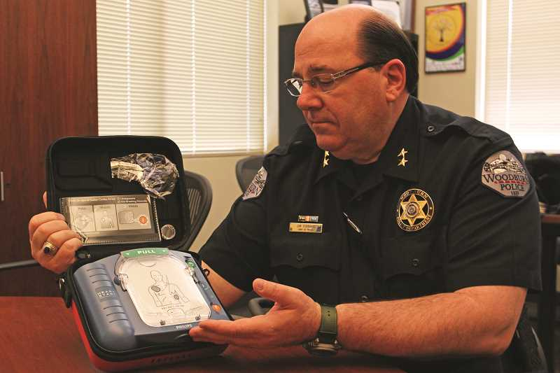 INDEPENDENT PHOTO: JULIA COMNES - Woodburn Police Chief Jim Ferraris thinks equipping more patrol cars with AEDs will save lives in the community. But the devices are expensive, so Ferraris is looking to the community for help in equipping 10 patrol cars with AEDs.