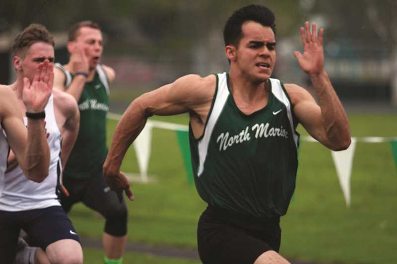 PHIL HAWKINS - After capturing the Oregon West long jump and triple jump conference titles, North Marion senior Ulises Vargas narrowly missed out on qualifying for state in the 100 after placing third in the finals.