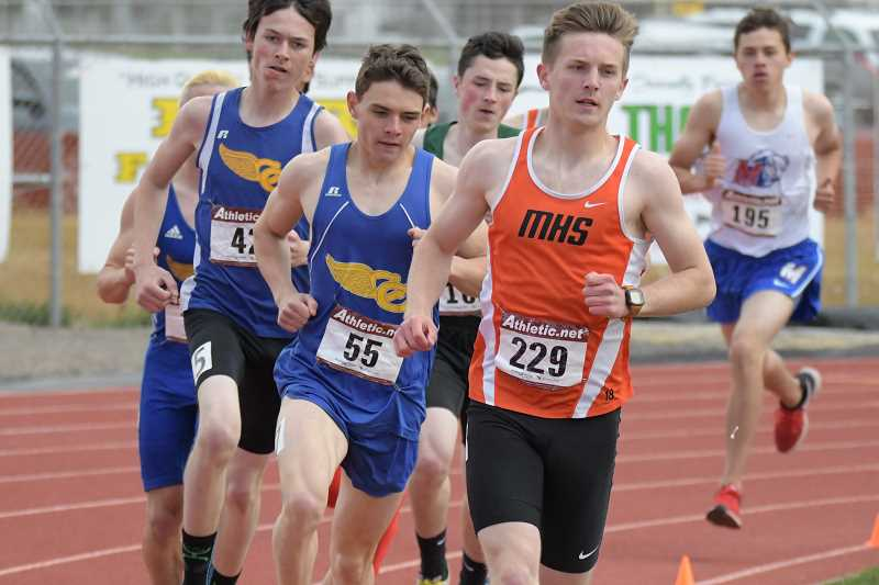 PAMPLIN MEDIA GROUP PHOTO: LON AUSTIN  - Molalla senior Matthew Borowzcak leads the pack in the 3,000 meters finals race during the Tri-Valley district meet at Crook County High School last Saturday. Borowzcak set a personal record to take first in the event, along with the 1,500 meters race.