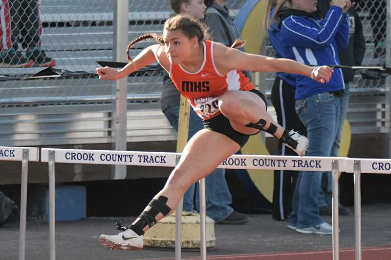 PAMPLIN MEDIA GROUP PHOTO: LON AUSTIN  - Molalla senior Desirae Desrosiers leaps over a hurdle at the Tri-Valley district meet Saturday. DesRosiers