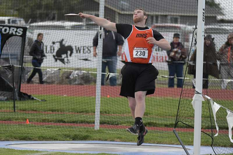 PAMPLIN MEDIA GROUP PHOTO: LON AUSTIN  - Molalla senior Mont Child takes first in the Discus at the Tri-Valley district meet Saturday. Child also took first in the Shot Put and wil look to defend his title in the event and hope to place in the Discus.