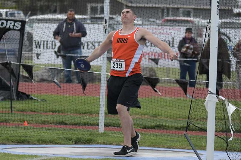 PAMPLIN MEDIA GROUP PHOTO: LON AUSTIN  - Molalla senior Berkely Olsen throws the Discus at the Tri-Valley district meet last weekend. Olsen took second in the event and qualified for the state meet this weekend.