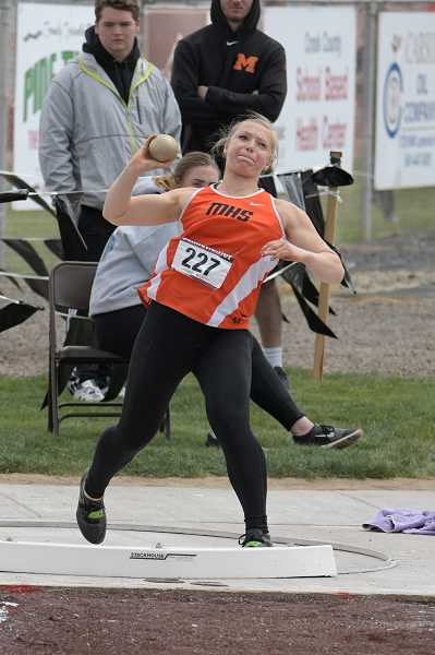 PAMPLIN MEDIA GROUP PHOTO: LON AUSTIN  - County Christian sophomore Katie Sandberg throws the Shot Put at the Tri-Valley district meet last weekend. She took second in the event and qualified for the state meet this weekend.