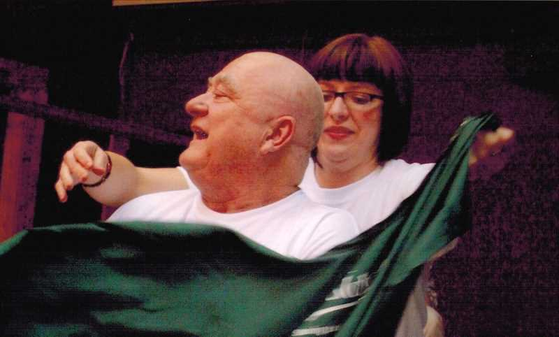 COURTESY OF PAUL HEINEMAN - At the St. Baldrick's fundraiser, a beautician whips off a cape from Paul Heineman's shoulders after shaving off all his hair so it could be made into a wig.
