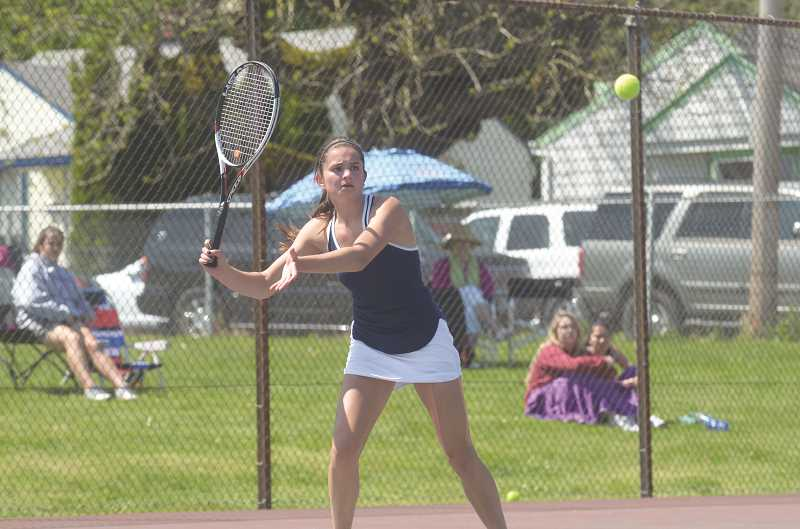 SPOKESMAN PHOTO: COREY BUCHANAN - Wilsonville junior Sidney Lowry won her second consecutive Northwest Oregon Conference district title Wednesday, May 10 at Parkrose High School.