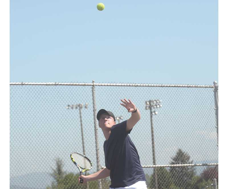SPOKESMAN PHOTO: COREY BUCHANAN - Wilsonville boys tennis player Kyle Andrews reached the district tournament finals with teammate Aidan Green Wednesday, May 10 at Parkrose High School.