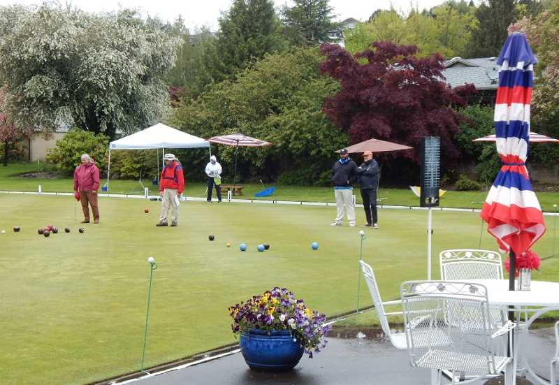BARBARA SHERMAN - Lawn bowlers braved the rain to play on Saturday morning, May 13, on the King City Bowling Green, but that was actually the best part of the day as a thundershower and hailstorm struck in the afternoon, cancelling play for the rest of the day.