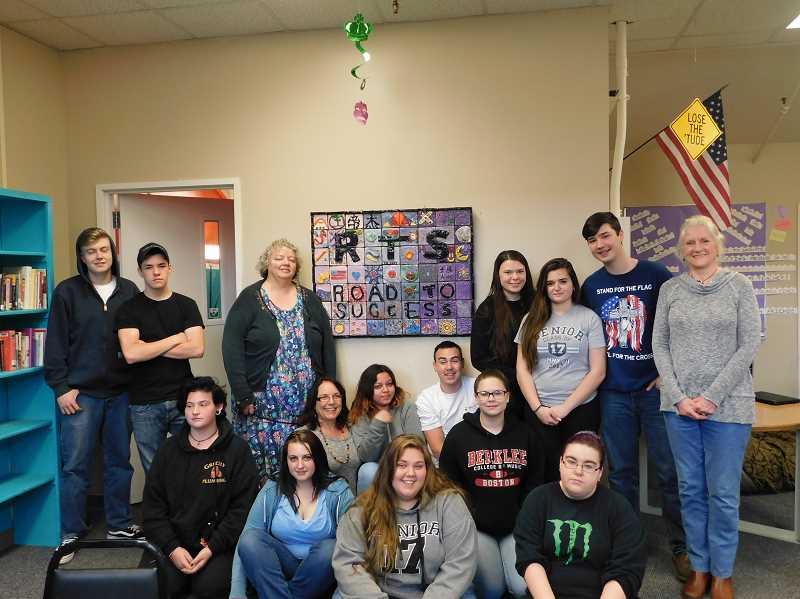 ESTACADA NEWS PHOTO: EMILY LINDSTRAND - Students in the Road to Success alternative high school program and community members gather around an art piece students completed earlier in the year.