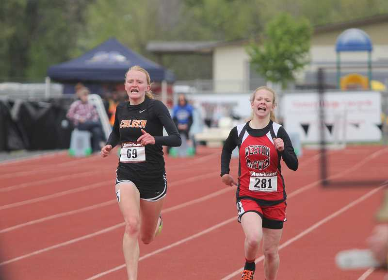 WILL DENNER/MADRAS PIONEER - Culver's Emma Knepp (left) outlasted Weston-McEwen's Katie Vescio (right) in the 2A girls 1,500 meters by .01 of a second.