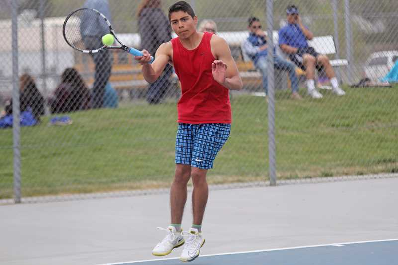 WILL DENNER/MADRAS PIONEER - Madras senior Obed Eriza won matches over Will Dutil of Estacada and Sam Anthony of Cascade last Wednesday at day two of districts in Prineville, thus clinching a spot in the 4A/3A/2A/1A State Tennis Championships in Corvallis Friday and Saturday.