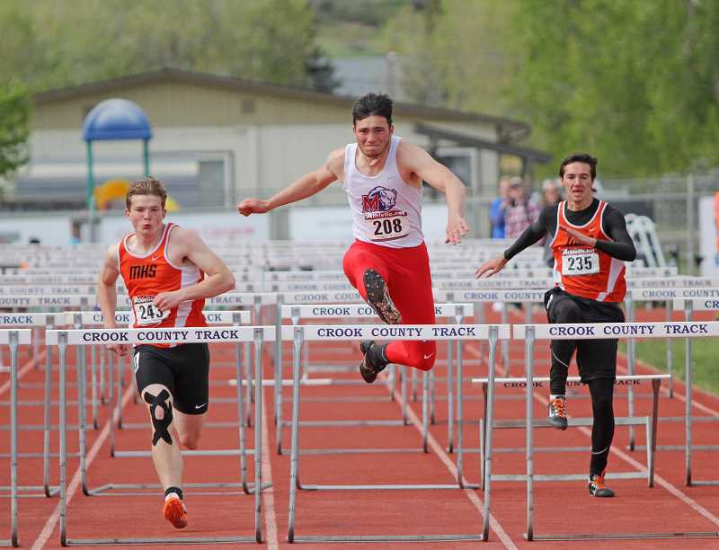 WILL DENNER/MADRAS PIONEER - Madras junior Harrison Manu (middle) exploded off the blocks in the 110-meter hurdle finals last Saturday in Prineville, beating Molalla's David Sumpter (left) and setting a PR of 16.20 seconds. Manu qualified for state with the win.