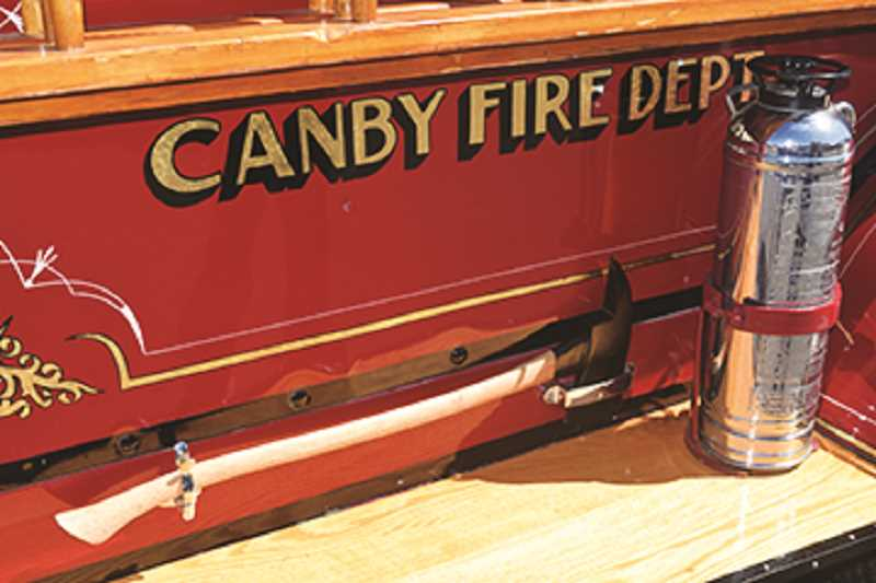 DANIEL PEARSON - Canby Fire's old-timey fire engine is located inside the lobby of the fire department.