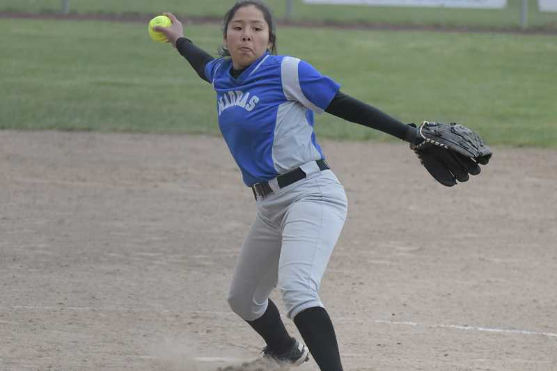 LON AUSTIN/FOR THE PIONEER - Jiana Smith-Francis came on to relieve Lizzie Steuart in the fourth inning for Madras.
