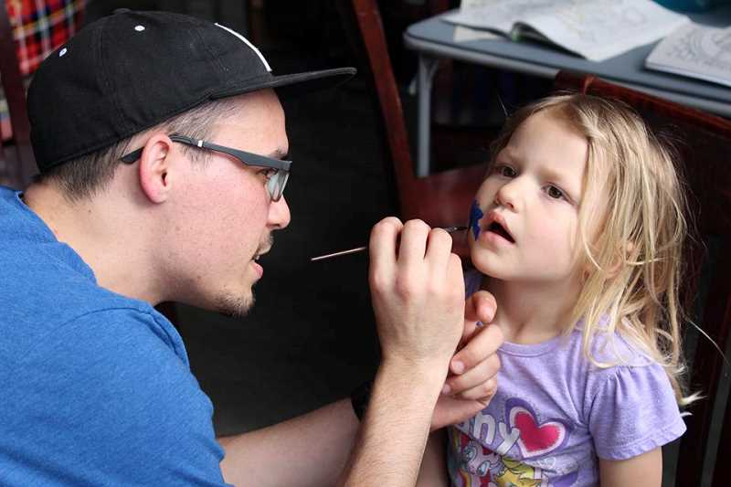 COURTESY OF FIDGETECH - The Second Annual Autism Family Fun Fest, held at Two Kilts Brewery, drew over 200 guests. Here a child gets her face painted by Steven Robbe as part of the days fun activities.