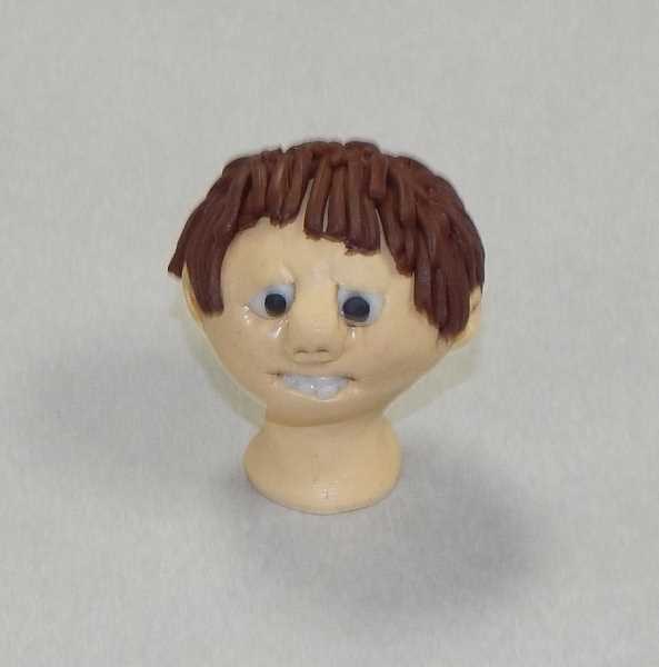 BARBARA SHERMAN - Susan Burson did an outstanding job creating a tiny head with such details as individual teeth and locks of hair.