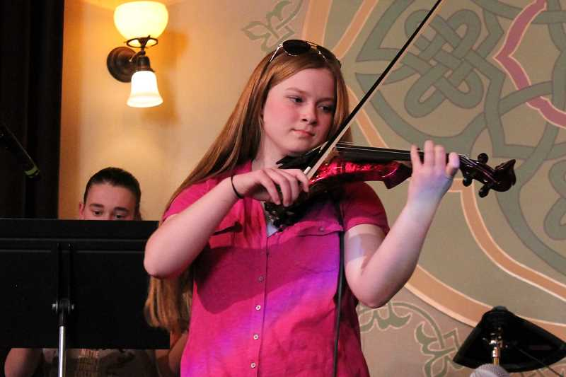 SPOKESMAN PHOTO: ANDREW KILSTROM - Natie Moore plays the violin for her band The Incendios Sunday, May 14 at McMenamins Old Church and Pub.